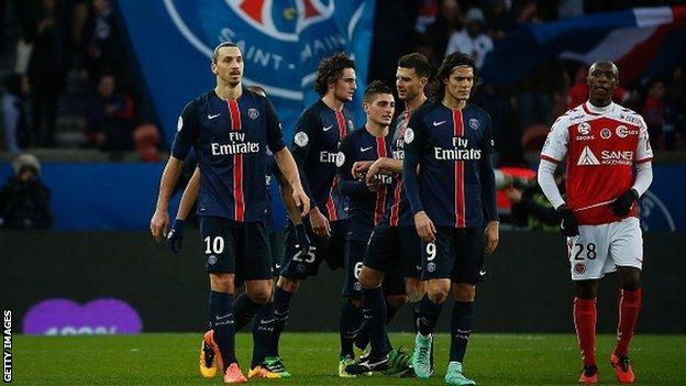 Paris St-Germain players celebrate a goal in Ligue 1