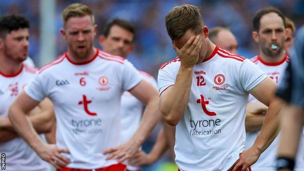 Tyrone's Kieran McGeary shows his upset after the final whistle