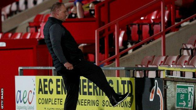Connah's Quay manager Andy Morrison reacts after his team conceded a penalty
