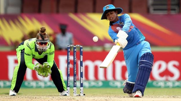 Mithali Raj of India bats with Mary Waldron wicket keeper of Ireland looking on during the ICC Women's World T20 2018 match between India and Ireland at Guyana National Stadium on November 15, 2018 in Providence, Guyana