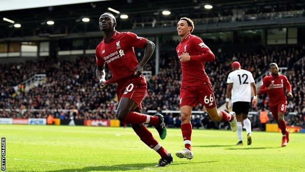 Sadio Mane celebrates scoring Liverpool's opening goal in victory over Fulham
