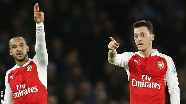 Mesut Ozil and Theo Walcott