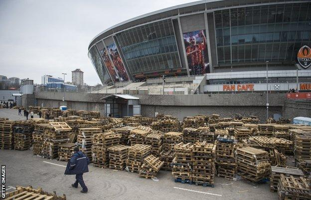 Shakthar stadium - pallets from aid packages stacked outside the ground