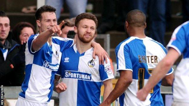 Matt Taylor celebrates with team-mates