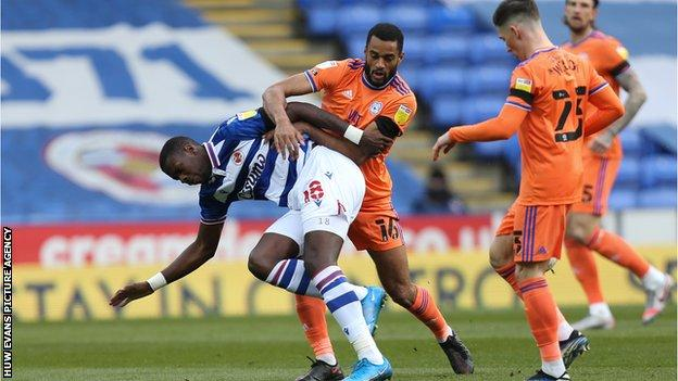 Curtis Nelson of Cardiff City and Lucas Joao of Reading compete for the ball