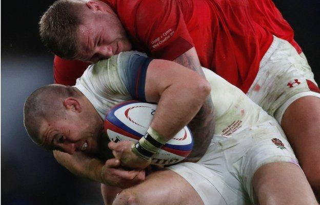 Mike Brown is tackled by Wales' Ross Moriarty