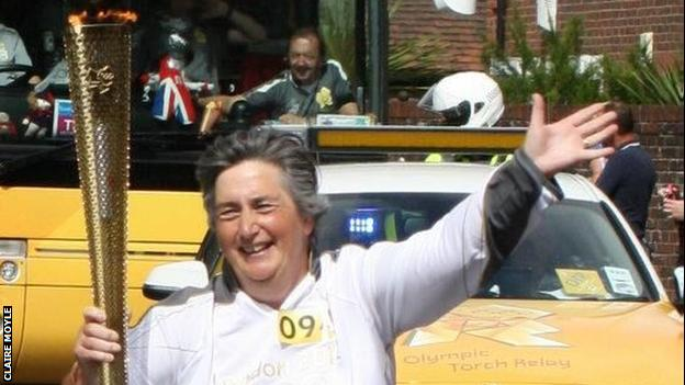 Claire Moyle carries the London 2012 Olympic torch
