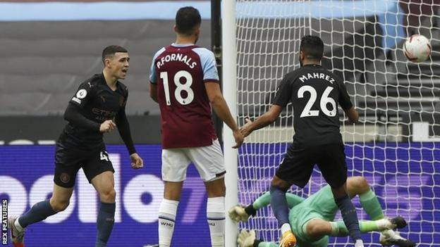 Phil Foden scores for Manchester City against West Ham