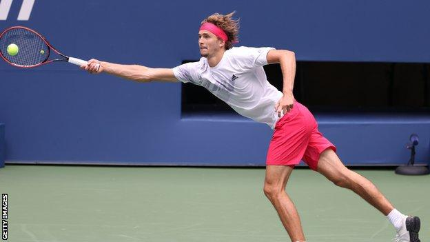 Alexander Zverev stretches to return a serve