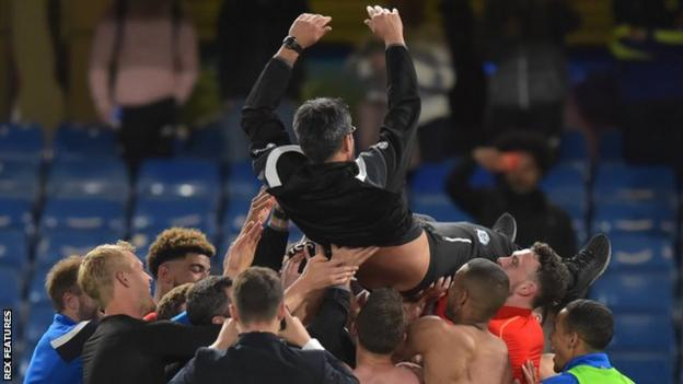Huddersfield boss David Wagner is lifted into the air by his players after the Terriers secure Premier League survival