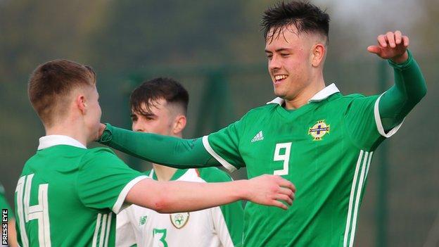 Northern Ireland's Callum Ferris celebrates after scoring
