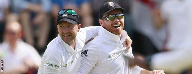 Adam Lyth celebrates a catch with Ian Bell