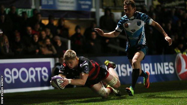 Aaron Wainwright dives over for a try as the with an Enisei defender trailing behind