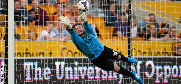 Newport goalkeeper Joe Day makes a diving save during the League Cup first-round match with Wolverhampton Wanderers