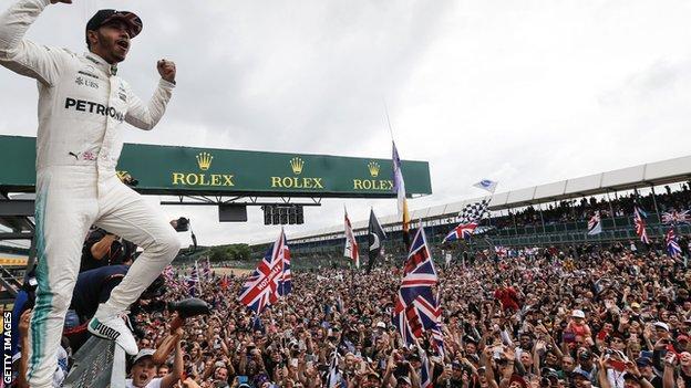 Lewis Hamilton celebrates Silverstone win