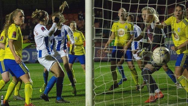 Ellie Brazil (third from left) scores a goal for Brighton against Birmingham City