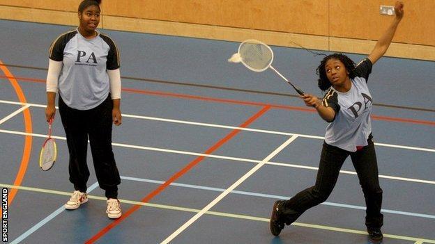 Girls playing badminton