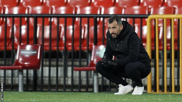 Diego Martinez crouches down during Granada's Europa League last 32 tie against Napoli