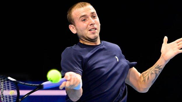 Britain's Dan Evans returns a shot against American Frances Tiafoe at the European Open in Antwerp