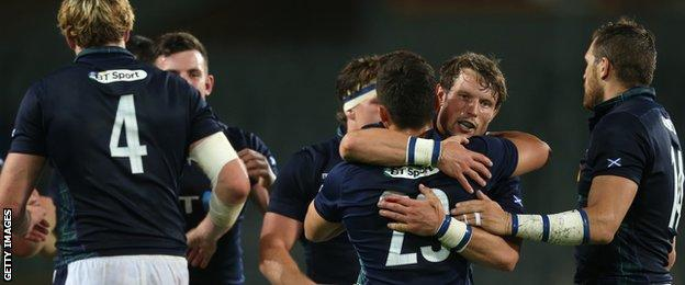 Scotland's Peter Horne celebrates with Damien Hoyland in Turin