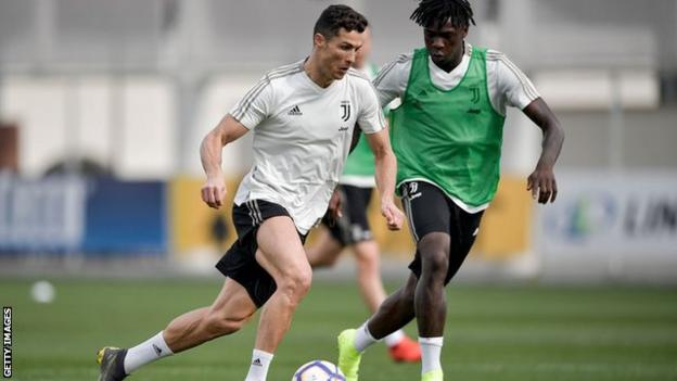 Cristiano Ronaldo and Moise Kean in training with Juventus