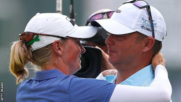 Stacy Lewis hugs Gerrod Chadwell