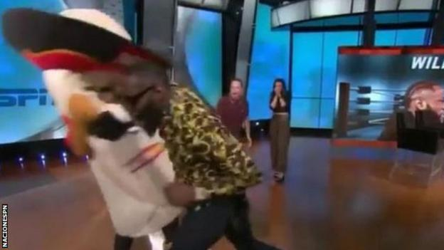 Deontay Wilder punching a mascot on a live American TV show.