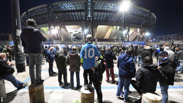 Fans gather outside Napoli's stadium