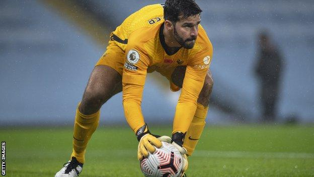 Alisson in action for Liverpool