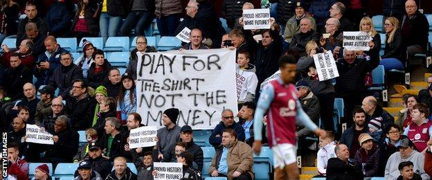 Villa fans hold up banners