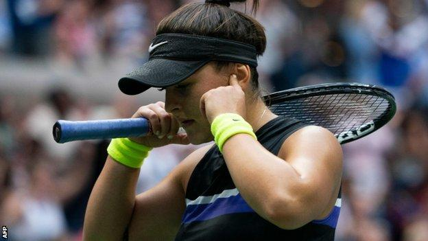 Bianca Andreescu puts her fingers in her ears