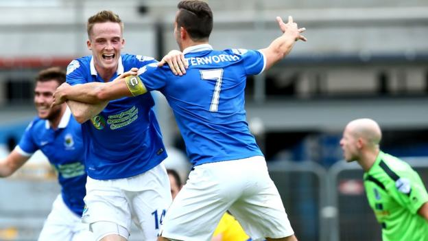 Linfield midfielder Aaron Burns celebrates the first of his two goals in the 4-0 victory over Ballymena United