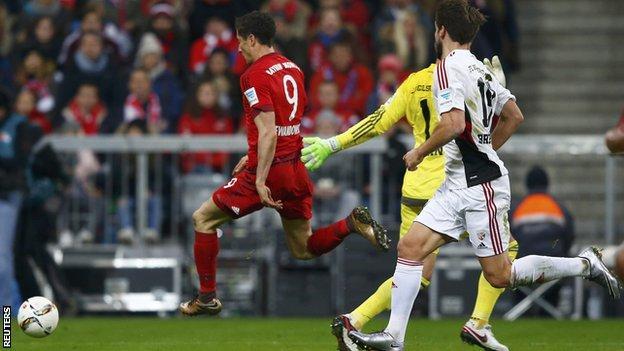 Bayern Munich's Robert Lewandowski scores against Ingolstadt