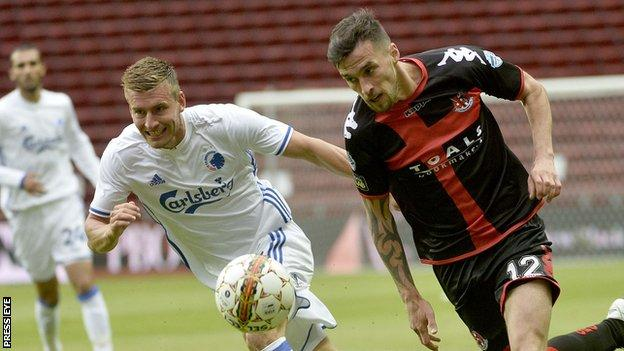 Christoffer Remmer and Declan Caddell vie for possession during the second leg