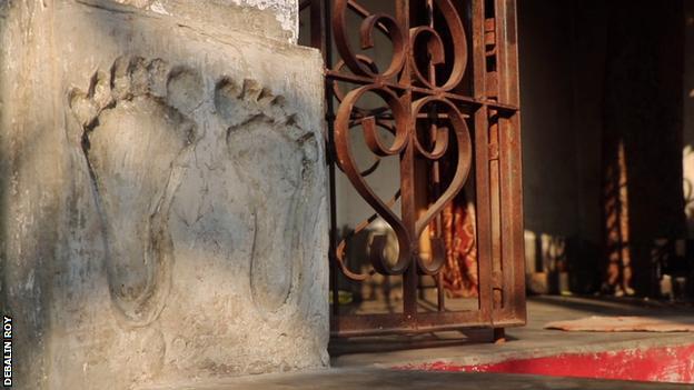A cast of Swapna Burman's footprint outside her family home