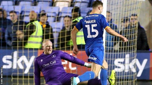 Brad Walker rounded Mansfield keeper Conrad Logan to score Shrewsbury's 94th-minute clincher
