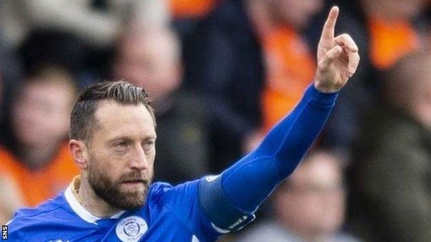 Queen of the South's Stephen Dobbie celebrates his opening goal against Dundee United at Palmerston Park