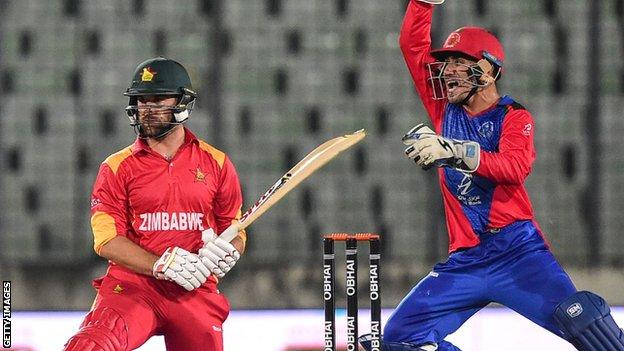 Zimbabwe's Ryan Burl in action against Afghanistan