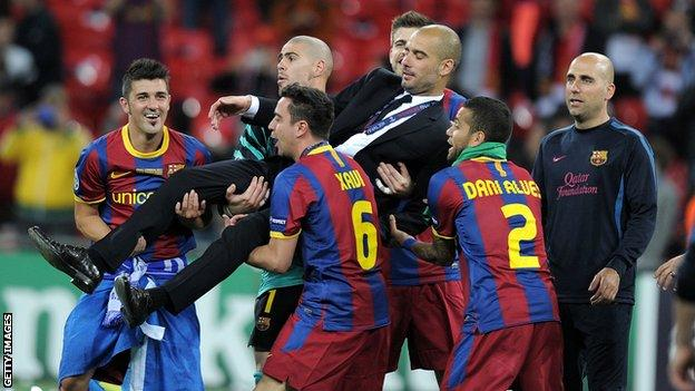 David Villa and his Barcelona team-mates lift coach Pep Guardiola after winning the 2011 Champions League final