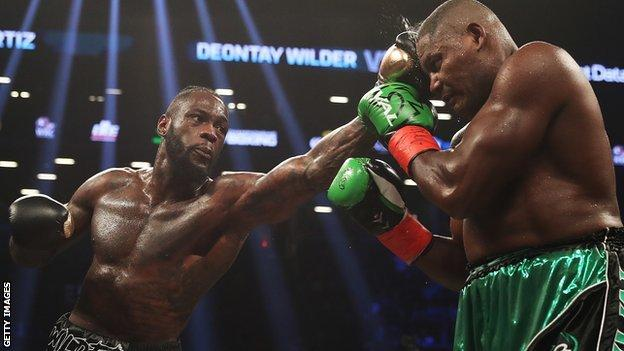 Deontay Wilder hits Luis Ortiz with a left jab