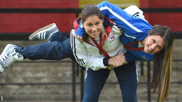 Louise Renicks holds her younger sister Kimberley aloft