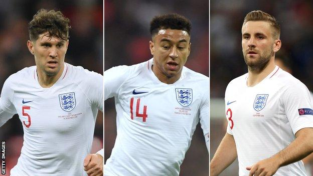 John Stones (left), Jesse Lingard (centre) and Luke Shaw