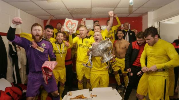 Cliftonville players celebrate in the dressing room after their League Cup final success against Ards