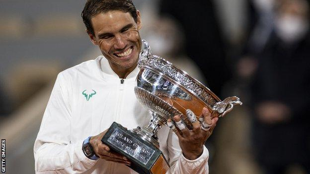 Rafael Nadal smiles with the French Open trophy