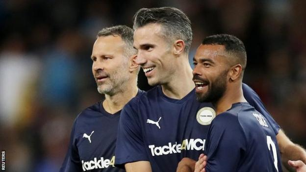 Robin van Persie (centre) celebrated his second half goal with Ryan Giggs (left) and Ashley Cole (right)