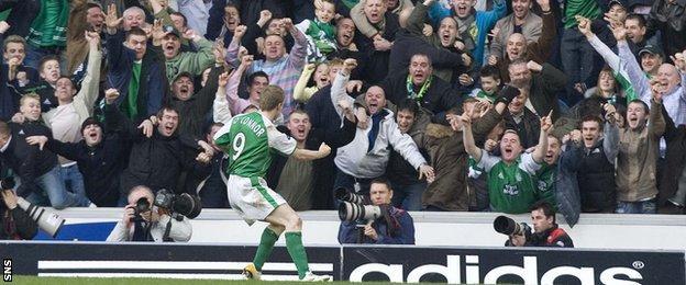 Gary O'Connor celebrates his goal at Ibrox