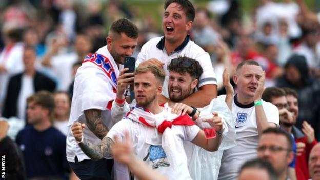 Manchester fans react after Manchester United's Harry Maguire scores England's second goal