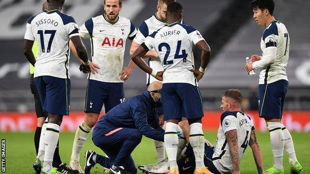 Tottenham defender Toby Alderweireld receives treatment on the pitch