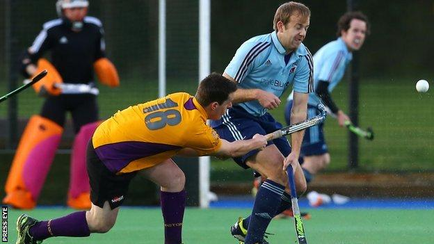 Belfast Harlequins's Christopher Lemon tries to block a Alan Patterson shot