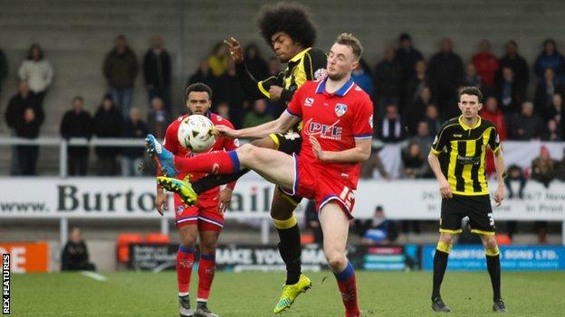Burton's Hamza Choudhury looks to win possession in midfield